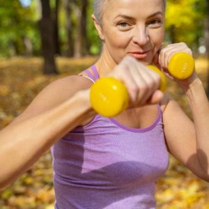 woman with yellow dumbbells