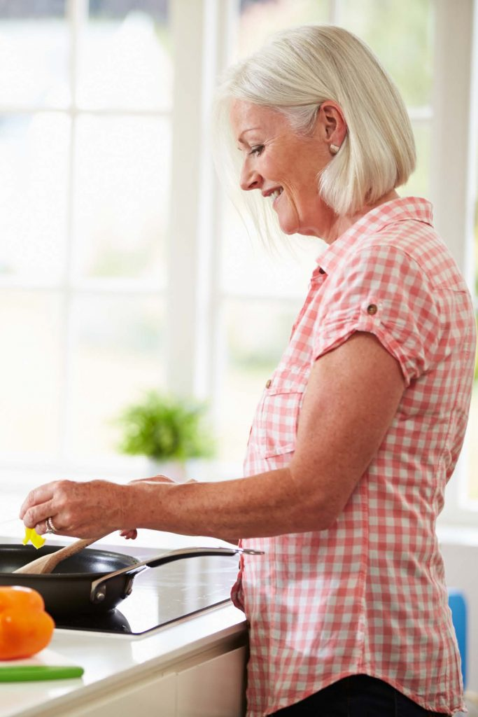 middle aged woman cooking