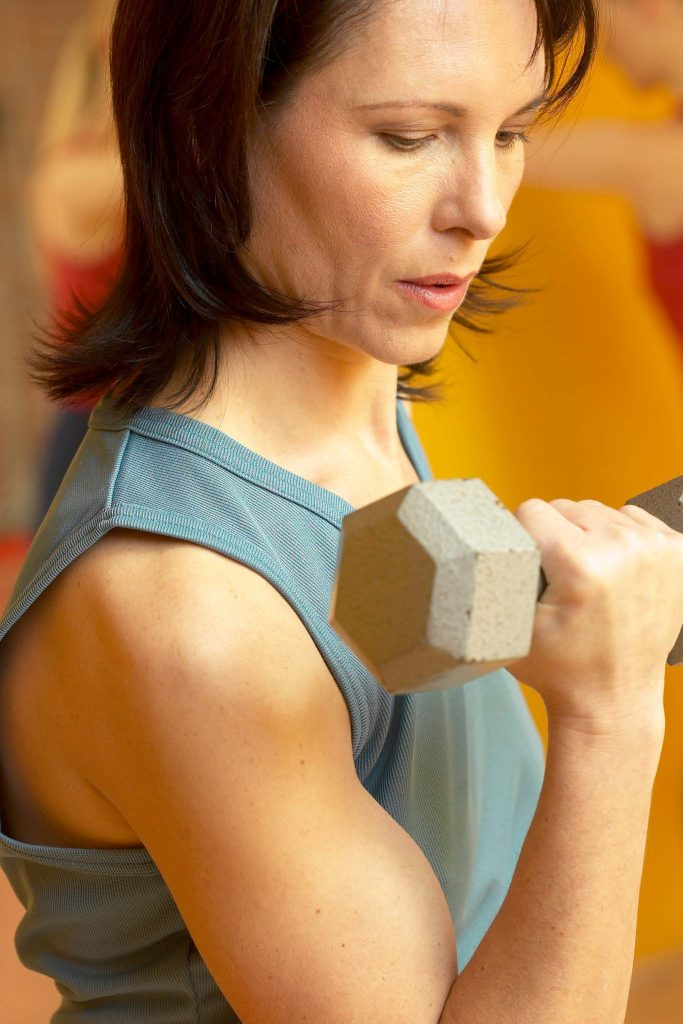 HodgeonRepeat - woman over 40 holding dumbbell