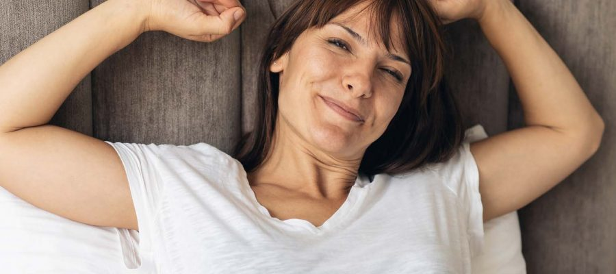 woman waking up refreshed from sleep