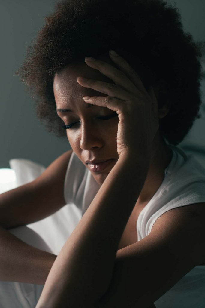 woman with insomnia sitting up in bed
