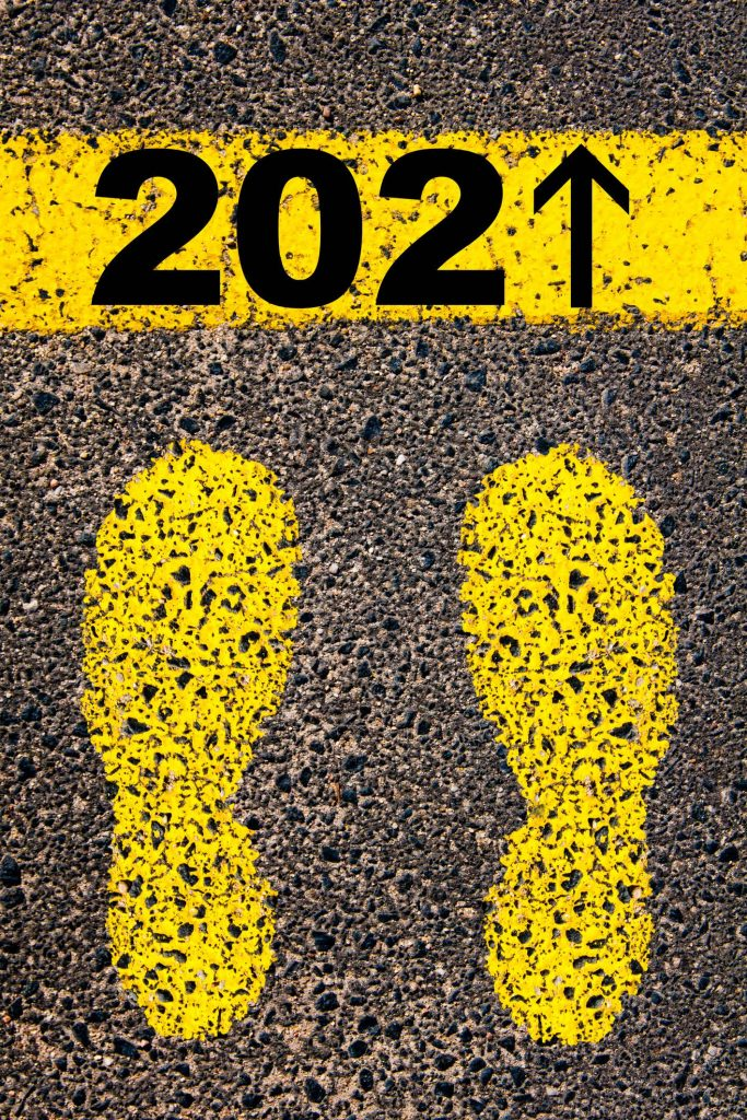 yellow footsteps on track in direction of 2021