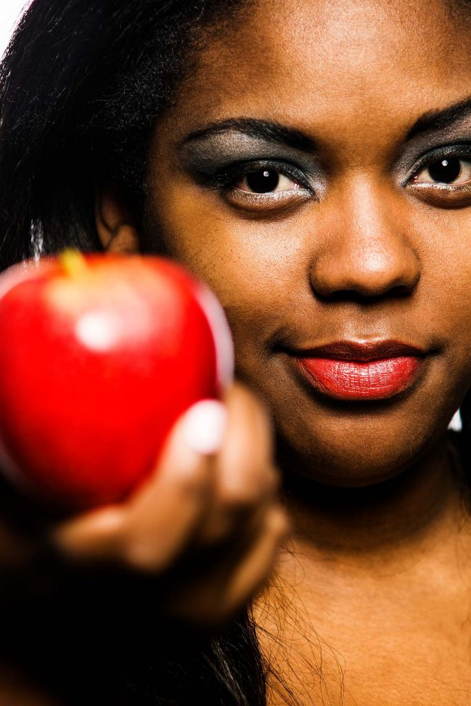 HodgeonRepeat blog - woman offering red apple