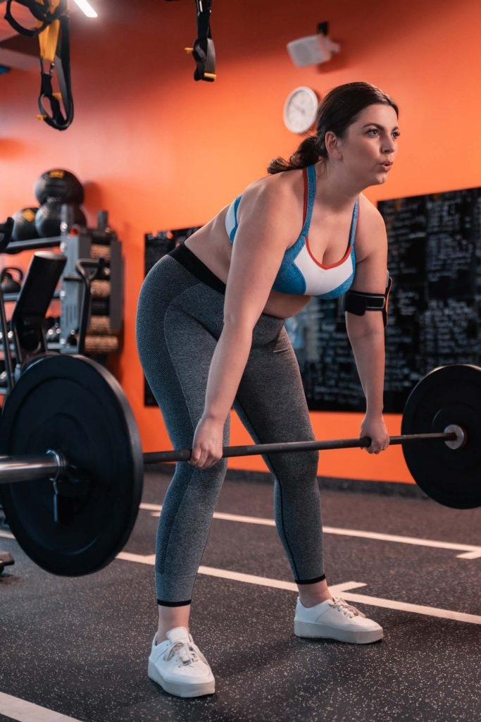 HodgeonRepeat blog - obese woman lifting barbell