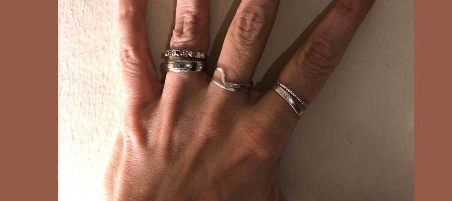 HodgeonRepeat blog - author Jill Hodge's hand with silver rings