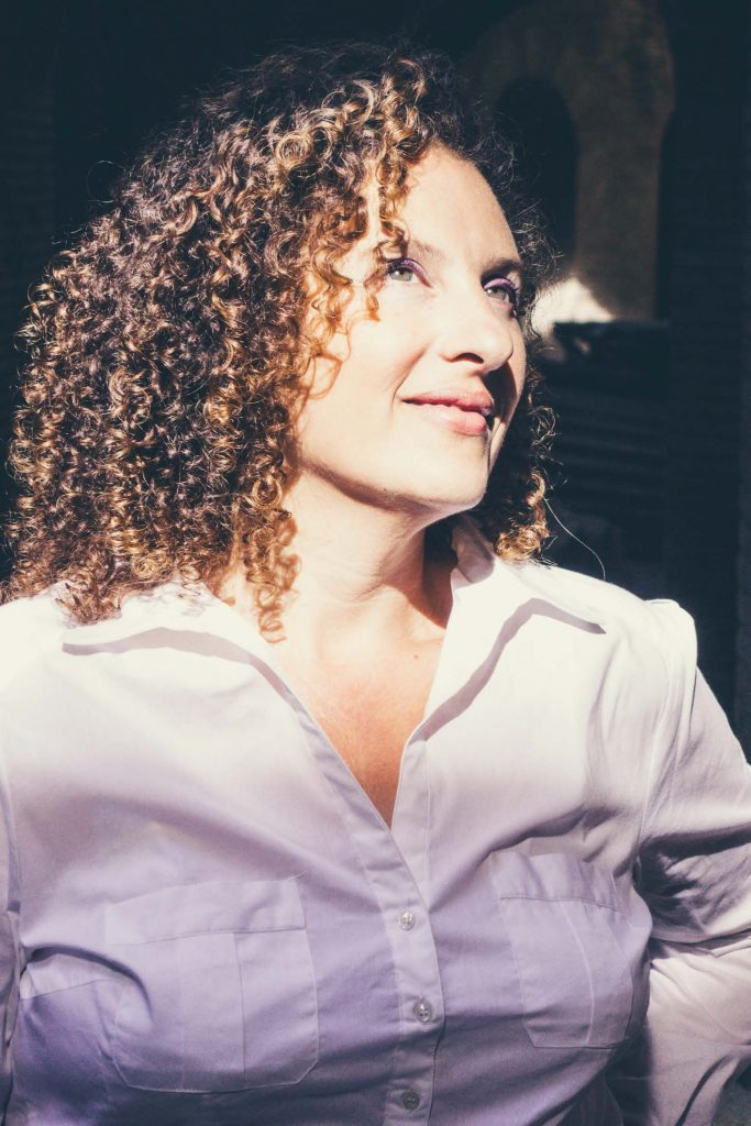 HodgeonRepeat blog - woman with curly hair looking up into the sunshine