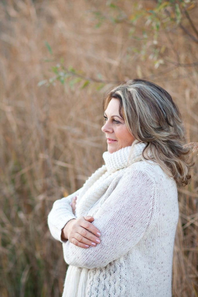 HodgeonRepeat blog - woman over 50 thinking while standing in field of grass