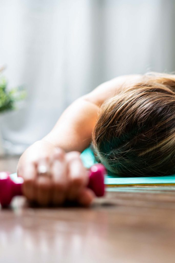 HodgeonRepeat blog - extreme fitness challenges -woman lying down from exhaustion