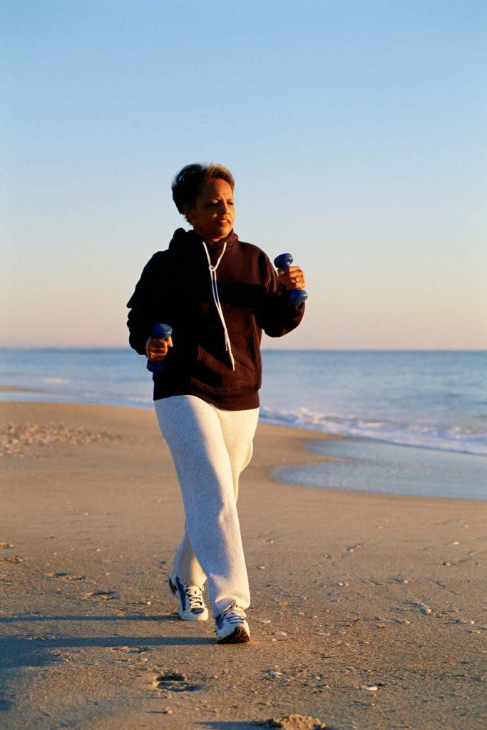 HodgeonRepeat blog - black woman walking on beach - 10-minute exercise rule