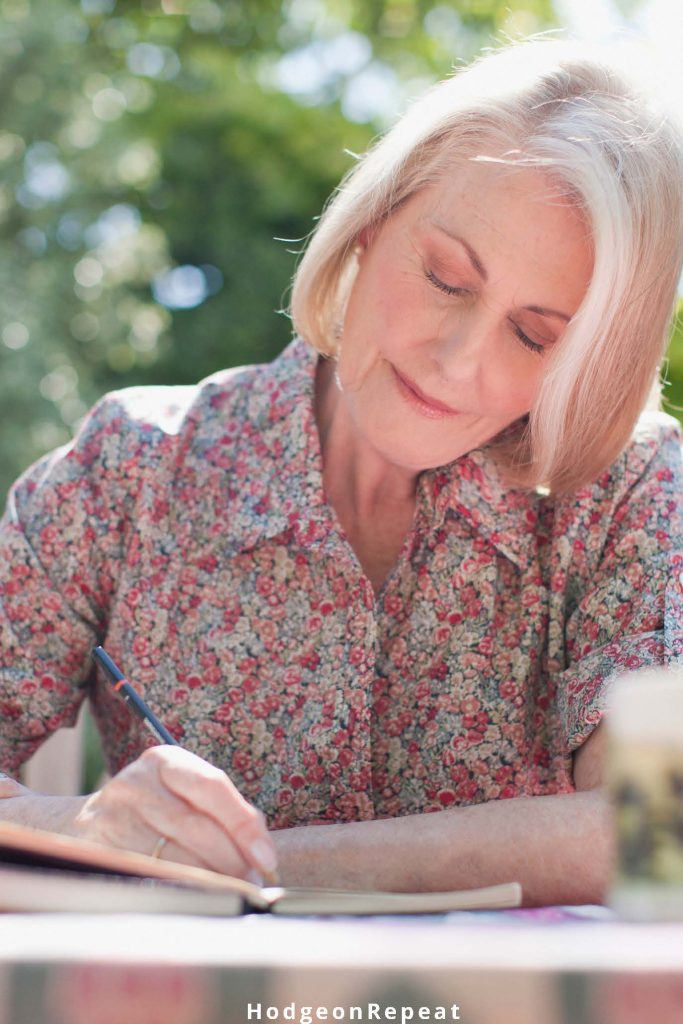 HodgeonRepeat blog - mature woman writing in journal - health and fitness journal prompts