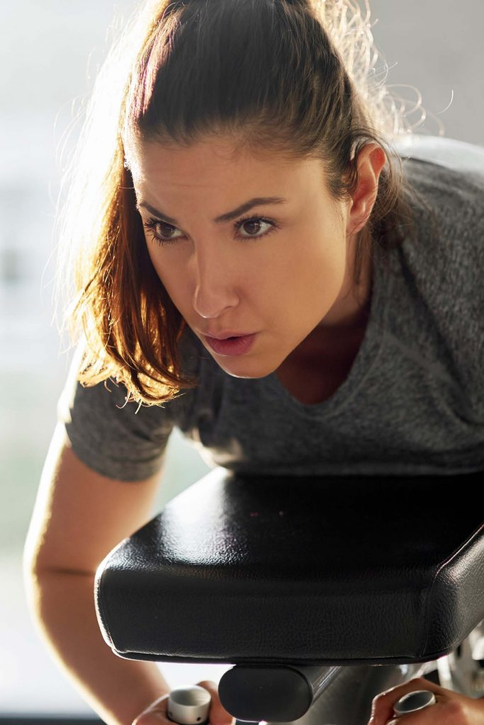 HodgeonRepeat blog - woman exercising with determined look on her face