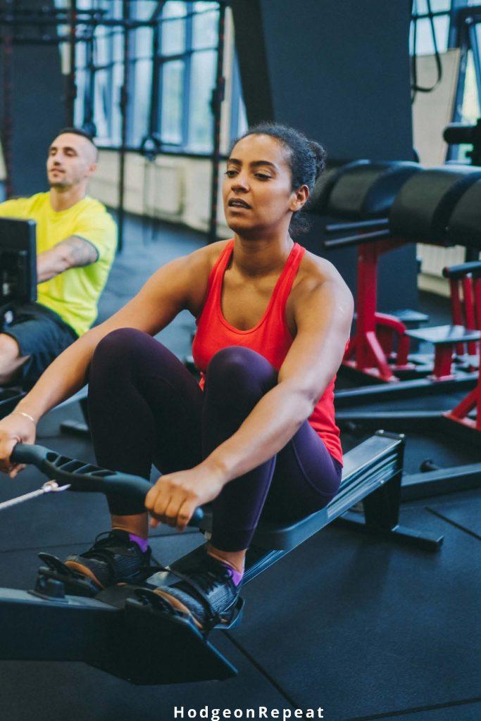 HodgeonRepeat blog - black woman in indoor rowing class
