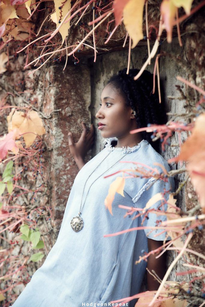 HodgeonRepeat blog - African American woman standing in garden and thinking