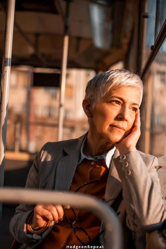 HodgeonRepeat blog - mature woman sitting on the bus with look of mental fatigue