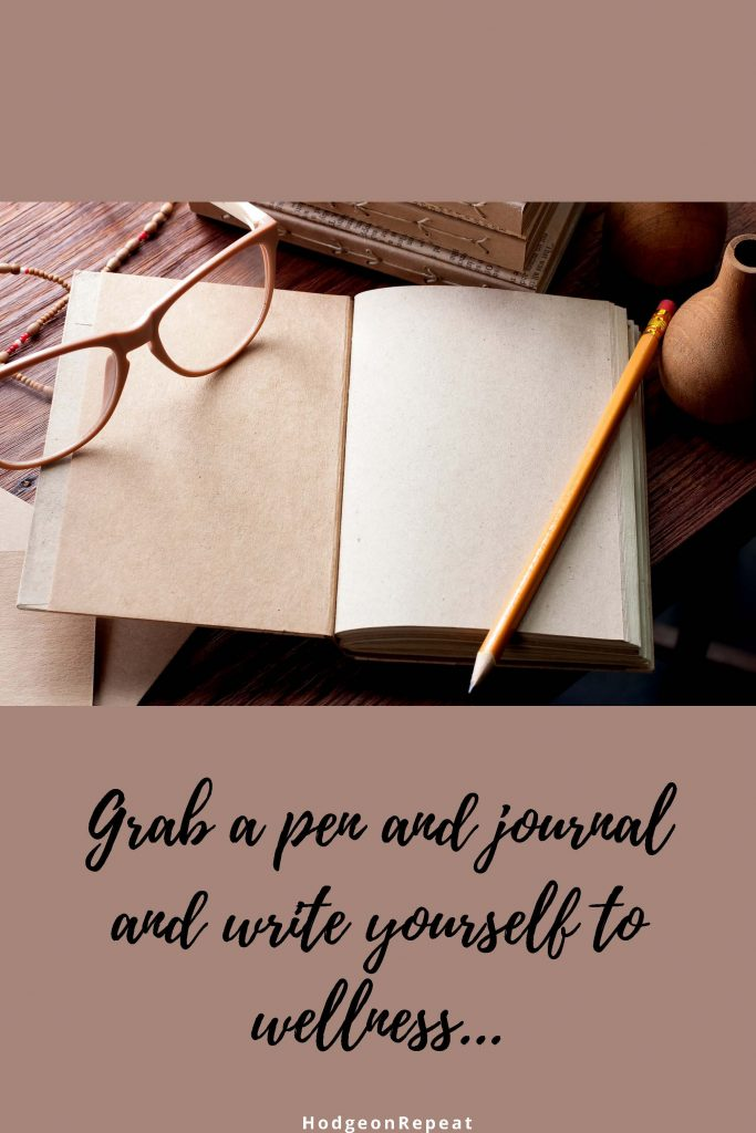 HodgeonRepeat blog - open journal with text below that reads grab a pen and journal and write yourself to wellness