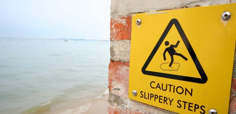 HodgeonRepeat - hold on to healthy habits - slippery steps caution sign next to beach